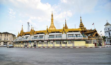 fascinate: YANGON, MYANMAR - October 12, 2013  Traffic in downtown around Sule pagoda in Yangon on October 12, 2013, in Yangon, Myanmar  The Sule Pagoda, a religious and historic site