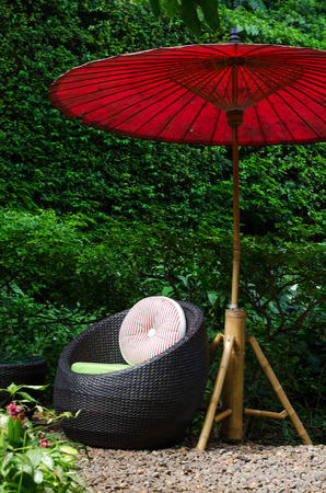 Modern chair of outdoors patio furniture in a backyard  photo