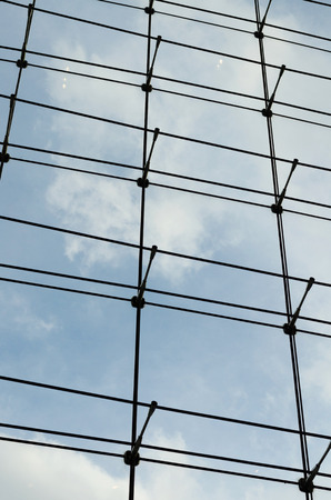 Glass curtain wall in a modern building, blue sky  photo