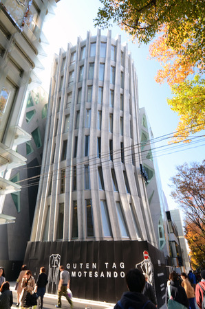 Tokyo, Japan - November 24, 2013: People walk by Futuristic Architecture on Omotesando Street on November 24, 2013, Omotesando street sometimes referred to as Tokyos Champs-Elysees. Here you can find famous brand name shops, cafes and restaurants for a m