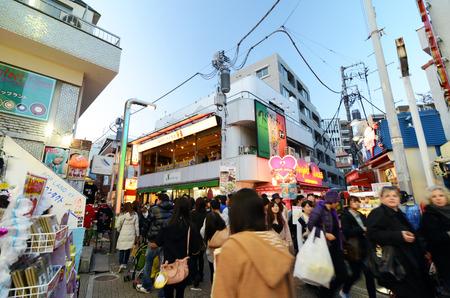 harajuku: Tokyo, Japan - November 24, 2013: Crowd at Takeshita street Harajuku on November 24, 2013 in Tokyo, Japan. Takeshita street is a street lined with fashion, cafes and restaurants in Harajuku.