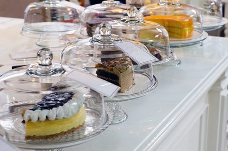 cake stand: Display of delicious cakes in vintage cafeteria