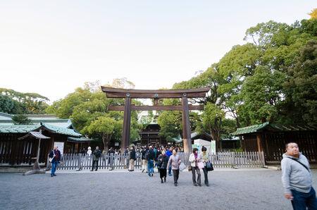 harajuku: Tokyo, Japan - November 23, 2013 : Tourist visit The Torii Gate standing at the entrance to Meiji Jingu Shrine Yoyogi Park on 2013 November 23, Tokyo Japan. Editorial