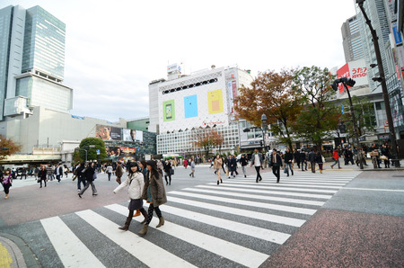 Tokyo, Japan - November 28, 2013: Crowds of people crossing the center of Shibuya in November 28 2013, the most important commercial center in Tokyo, Japan