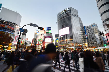 Tokyo, Japan - November 28, 2013: Crowds of people crossing the center of Shibuya district on November 28 2013, Shibuya is the most important commercial center in Tokyo, Japan