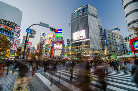 Tokyo, Japan - November 28, 2013: Crowd at the famed crossing of Shibuya district on November 28, 2013 in Tokyo, Japan. Shibuya is a fashion center and nightlife area.