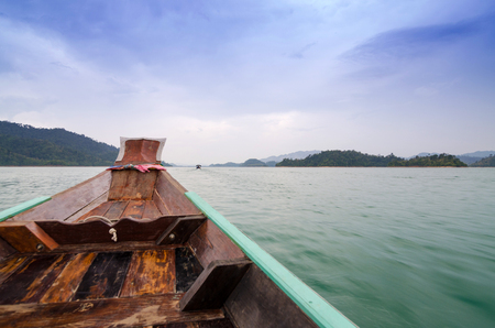 Beautiful mountains and natural attractions on long tail boat in Ratchaprapha Dam at Khao Sok National Park, Surat Thani Province, Thailand. photo