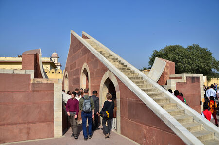 Jaipur, India - December 29, 2014: people visit Jantar Mantar observatory on December 29, 2014 in Jaipur, India. The collection of architectural astronomical instruments, were built by Sawai Jai Singh II in 1727-1734.