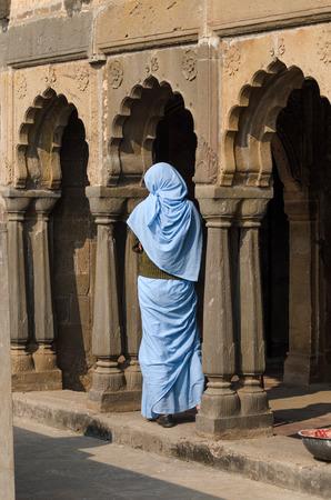 baori: Indian woman at Chand Baori Stepwell in Jaipur, Rajasthan, India.