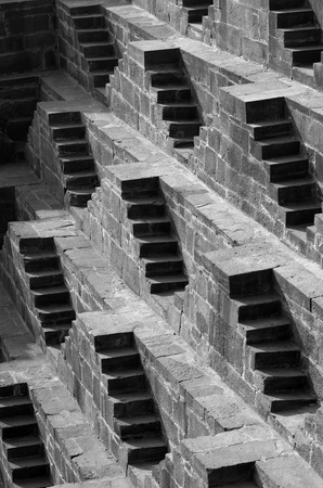 dausa: Steps at Chand Baori Stepwell in Jaipur, Rajasthan, India. (Black and White)