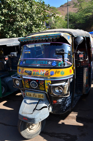 auto rickshaw: Jaipur, India - December 29, 2014:  Auto rickshaw taxis near Amber fort on December 29, 2014 in Jaipur, India. These taxis are popular type of transport among locals and tourists.