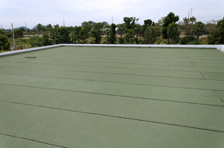 Membrane waterproofing, insulation on concrete slab.