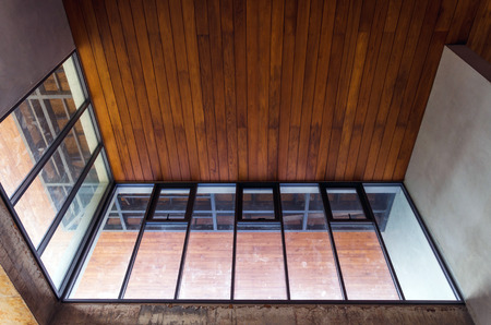 aluminum: Aluminum window with wooden ceiling in house under construction Stock Photo