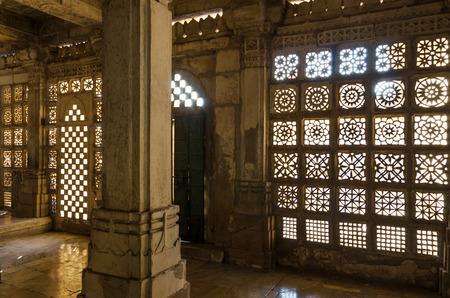 Carved stone grilles pattern at Sarkhej Roza mosque, Ahmedabad, India Redakční