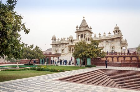 january 1: Jodhpur, India - January 1, 2015: Tourist visit The Jaswant Thada mausoleum on January 1, 2015 in Jodhpur, India. It is a white marble memorial built by Maharaja Sardar Singh of Jodhpur State in 1899 in memory of his father, Maharaja Jaswant Singh II.