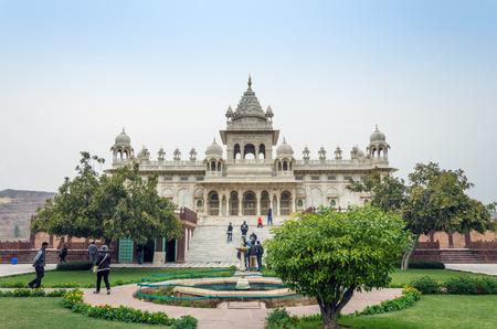 maharaja: Jodhpur, India - January 1, 2015: Tourist visit The Jaswant Thada mausoleum on January 1, 2015 in Jodhpur, India. It is a white marble memorial built by Maharaja Sardar Singh of Jodhpur State in 1899 in memory of his father, Maharaja Jaswant Singh II.