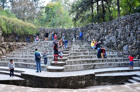 completely: Chandigarh, India - January 4, 2015: People visit Rock statues at the rock garden on January 4, 2015 in Chandigarh, India. The rock garden was founded by artist Nek Chand in 1957 and is made completely of recycled waste.