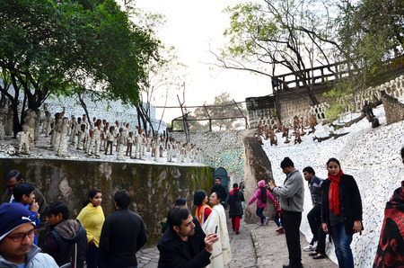 chand: Chandigarh, India - January 4, 2015: People visit Rock statues at the rock garden on January 4, 2015 in Chandigarh, India. The rock garden was founded by artist Nek Chand in 1957 and is made completely of recycled waste.