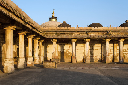 gujarat: Colonnaded of historic Tomb of Mehmud Begada, Sultan of Gujarat at Sarkhej Roza mosque in Ahmedabad, India