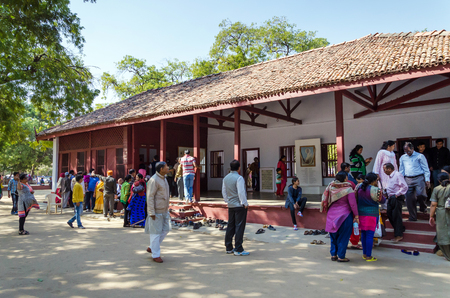mahatma: Ahmedabad, India - December 28, 2014: Tourist visit House of Mahatma and Kasturba Gandhi in Sabarmati Ashram. Sabarmati Ashram is the spiritual center founded by Mahatma Gandhi in 1917, headquater of freedom fighting