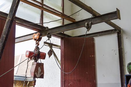 pulley: Abandoned rusty crane with pulley