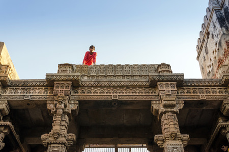 toran: Ahmedabad, India - December 25, 2014: Indian People visit Adalaj Stepwell in Ahmedabad, Gujarat, India on December 25, 2014. The stepwell was built in 1499 by Muslim king Mohammed Begda for Queen Rani Roopba, wife of Veer Singh, the Vaghela chieftain.