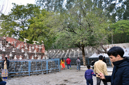 garden waste: Chandigarh, India - January 4, 2015: Tourist visit Rock statues at the rock garden on January 4, 2015 in Chandigarh, India. The rock garden was founded by artist Nek Chand in 1957 and is made completely of recycled waste.