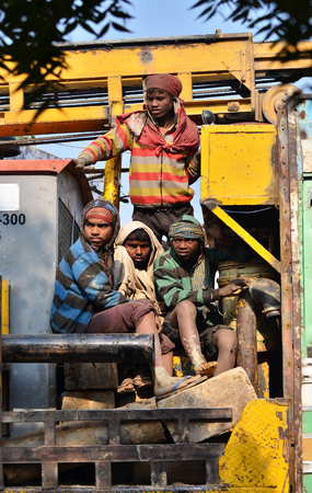 overcrowded: Jaipur, India - December 30, 2014: Unidentified travellers, mostly construction workers on the truck on MDecember 30, 2014 near Jaipur, India. Transport for workers is often overcrowded.