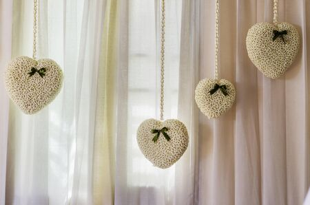 decotated: Crown flower hearts decotated on white curtain for Valentine