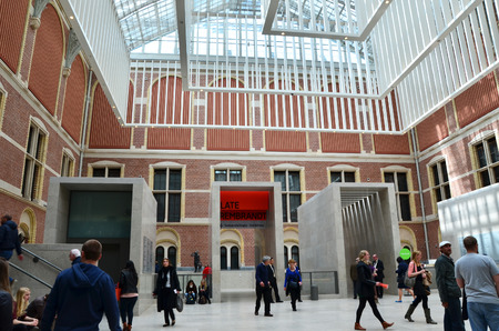atrium: Amsterdam, Netherlands - May 6, 2015: Tourist in the modern atrium Rijksmuseum on May 6, 2015. The original interior courtyards have been redesigned to create the imposing new entrance space of the Atrium