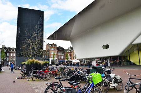 museum visit: Amsterdam, Netherlands - May 6, 2015: People visit famous Stedelijk Musem in Amsterdam located in the museum park, Netherlands on May 6, 2015