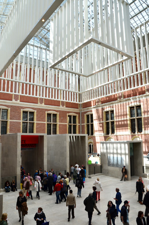 redesign: Amsterdam, Netherlands - May 6, 2015: Tourist at the Main hall of the Rijksmuseum in Amsterdam on May 6, 2015. The original interior courtyards have been redesigned to create the imposing new entrance space of the Atrium Editorial
