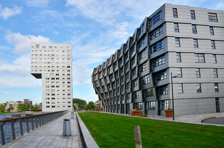 almere: Almere, Netherlands - May 5, 2015: Exterior of modern apartment buildings in Almere, Flevoland. Almere is the newest city in the Netherlands. Editorial