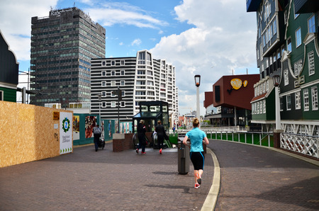 zaandam: Zaandam, Netherlands - May 5, 2015: People walk on a pedestrian zone in Zaandam, Netherlands. Zaandam was a leading city in the first Industrial Revolution. Into the second half of the 20th century, Zaandam was still an important lumber port. Editorial