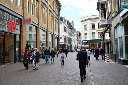 The Hague, Netherlands - May 8, 2015: People shopping on venestraat shopping street in The Hague, Netherlands. on  May 8, 2015. The Hague is the capital city of the province of South Netherlands. With a population of 515,880 inhabitants.