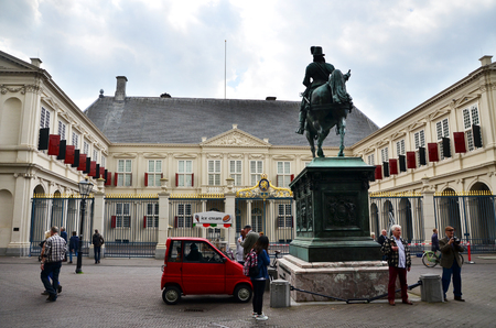 The Hague, Netherlands - May 8, 2015: People visit Noordeinde Palace, the Hague, Netherlands. Hague is the capital of the province South Netherlands.on May 8, 2015.