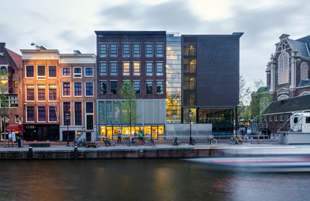 Amsterdam, Netherlands - May 7, 2015: Tourist visit Anne Frank house and holocaust museum in Amsterdam, the Netherlands, on May 7, 2015. Anne Frank house is a popular tourist destination