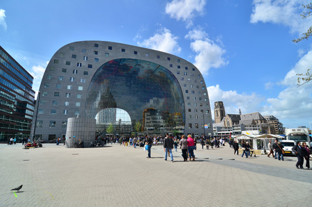 culinary arts: Rotterdam, Netherlands - May 9, 2015: People visit Markthal (Market hall) a new icon in Rotterdam. The covered food market and housing development shaped like a giant arch by Dutch architects MVRDV. Editorial