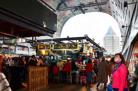 housing development: Rotterdam, Netherlands - May 9, 2015: People visit Markthal (Market hall) a new icon in Rotterdam. The covered food market and housing development shaped like a giant arch by Dutch architects MVRDV. Editorial