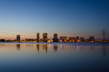 almere: skyline of the modern city center of Almere, Flevoland, The Netherlands. Twilight time.