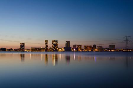 flevoland: skyline of the modern city center of Almere, Flevoland, The Netherlands. Twilight time.