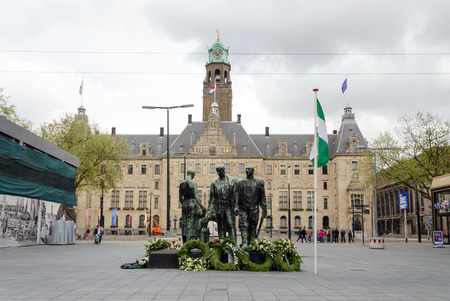 wilhelmina: Rotterdam, Netherlands - May 9, 2015: People visit Town hall of Rotterdam view from Stadhuisplein. The foundation stone was laid by Queen Wilhelmina on July 15, 1915.