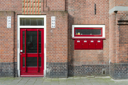 Door and Mailbox outside apartment building in Amsterdam, Netherlands photo