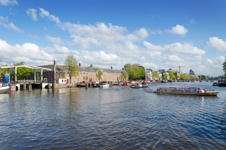 amstel: Tourist Boats on Amstel River in Amsterdam, The Netherlands Stock Photo