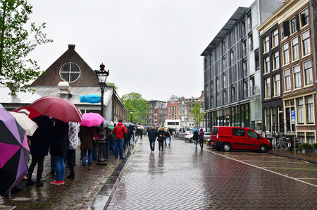 frank: Amsterdam, Netherlands - May 16, 2015: People queuing at the Anne Frank house and holocaust museum in Amsterdam, Netherlands, on May 16, 2015. Anne Frank house is a popular tourist destination. Editorial