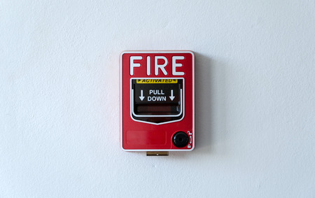 building backgrounds: Fire alarm switch on white wall Stock Photo