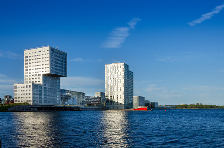 almere: Almere, Netherlands - May 5, 2015: Skyline apartment buildings of Almere Stad, Netherlands - Silverline, The wave and Almere Towers at Weer Water
