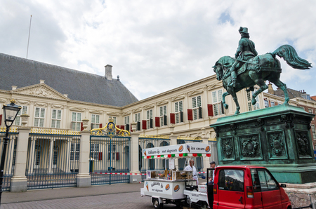 The Hague, Netherlands - May 8, 2015: People visit Noordeinde Palace, the Hague, Netherlands. Hague is the capital of the province South Netherlands.
