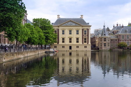 museum visit: The Hague, Netherlands - May 8, 2015: People visit Mauritshuis Museum in The Hague, Netherlands.The museum houses the Royal Cabinet of Paintings which consists of 841 objects, mostly Dutch Golden Age paintings.