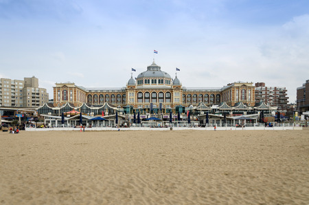 scheveningen: The Hague, Netherlands - May 8, 2015: Tourists at Kurhaus of Scheveningen, The Hague in the Netherlands is a hotel which is called the Grand Hotel Amrâth Kurhaus The Hague since October 2014. It is located in the main seaside resort area, near the beac Editorial